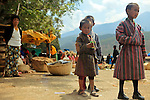 Asia, Bhutan, Wangdue. Three small Bhutanese boys at the market of Wangdue.