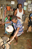 Man and his grandsons playing traditional Garifuna music and dancing, in the Garifuna village of Triunfo de la Cruz, Honduras...