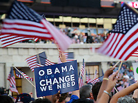 """Obama for the Change We Need"" sign with American flags on the floor of the Democratic National Convention, Invesco Field at Mile High Stadium, Denver, Colorado, August 28, 2008."