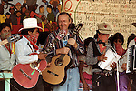 Uruguayan musician Daniel Viglietti sings along with Zapatistas during the closing of the Zapatista Intergalactica gathering in the stronghold of Oventic, in southern Chiapas state, July 27, 1996. The Zapatista rebels gathered with intellectuals, journalist, writers and artists in the strongholds of Oventic and La Realidad durigna Forum in Defense of Humanity and Against the Neo-liberalism. . Photo by Heriberto Rodriguez