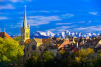 The Church of Saints Peter and Paul in the medieval city center of Bern, with peaks of the Swiss Alps behind, Canton Bern, Switzerland