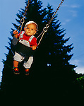 Child, girl  (18-24 months) swinging on swing