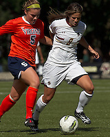 Boston College forward Stephanie McCaffrey (9) dribbles and University of Virginia midfielder/defender Olivia Brannon (5) defends. Boston College defeated University of Virginia, 2-0, at the Newton Soccer Field, on September 18, 2011.
