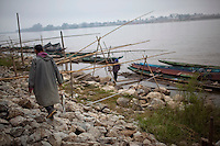 Thai fishermen on the Mekong River in Sop Ruak, Thailand. Photo taken on Thursday, December 10, 2009. Kevin German / Luceo Images