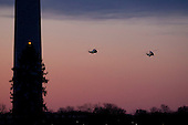 Marine One, carrying United States President Barack Obama and the first family, and a decoy helicopter approach the South Lawn of the White House in Washington, D.C., U.S., on Tuesday, January 3, 2012. The first family arrived after a 10-day vacation in Hawaii. .Credit: Andrew Harrer / Pool via CNP