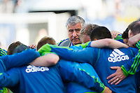 Seattle Sounders head coach Sigi Schmid huddle with the team  prior to playing the Philadelphia Union. The Philadelphia Union and the Seattle Sounders played to a 2-2 tie during a Major League Soccer (MLS) match at PPL Park in Chester, PA, on May 4, 2013.