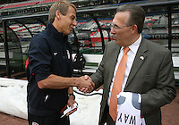 MEXICO CITY, MEXICO - AUGUST 15, 2012:  Jurgen Klinsmann coach of the USA MNT greets USA ambassador to  Mexico Earl Anthony Wayne before an international friendly match at Azteca Stadium, in Mexico City, Mexico on August 15.