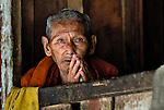 An old Buddhist monk chanting in Luang Prabang, Laos.
