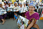 """Women participate in a vigil outside a Phnom Penh court on December 14, 2012, during a hearing in which judges denied an appeal by Mam Sonando, a Cambodian radio journalist and human rights activist. Mam Sonando was sentenced in October 2012 to 20 years in prison for """"insurrection,"""" despite local and international calls for his release."""