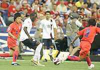 Josmer Altidore slips the ball through the Korean defense. Republic of Korea met USA in the second game of a doubleheader at the Olympic stadium, Montreal, Canada on June 30 2007, in the opening game of the FIFA U20 World. The game ended in a 1-1 tie.