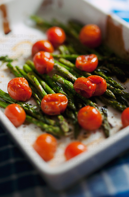 Roast Asparagus with Tomatoes; a drizzle of oil and pepper ontop