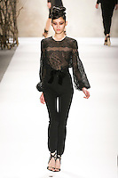 Ming Xi walks runway in a Monique Lhuillier Fall 2011 outfit, during Mercedes-Benz Fashion Week Fall 2011.
