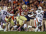 FSU running back Devonta Freeman slips through the Auburn defense during the BCS national title game at the Rose Bowl in Pasadena, California on January 6, 2014.  Florida State Seminoles defeated the Auburn Tigers 34-31.