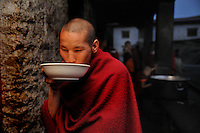A Lama, who is a student at Kharchhu Monastry (which is a buddhist school and college) having his dinner in the evening. These lamas lead a very modest life and have simple food three times a day. Arindam Mukherjee....