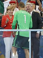 Chancellor of Germany Angela Merkel and President of Germany Joachim Gauck congratulate Goalkeeper Manuel Neuer of Germany
