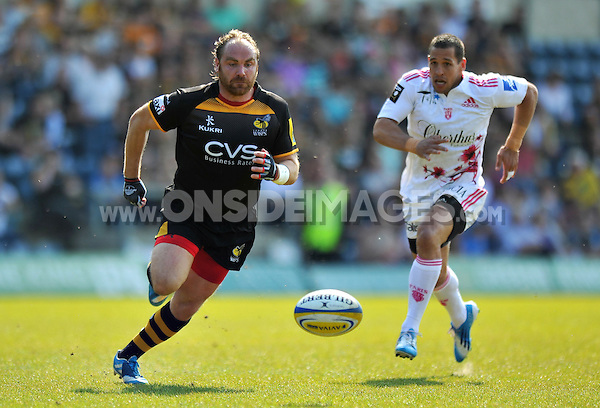 Andy Goode chases after the ball. European Champions Cup play-off, between London Wasps and Stade Francais on May 18, 2014 at Adams Park in High Wycombe, England. Photo by: Patrick Khachfe / JMP