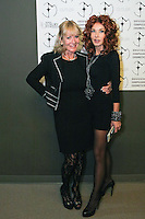 (l) Kristina Cogswell from Luxury is a Necessity, and (r) fashion designer Eva Minge, pose backstage after the DNA Minge range Fall/Winter 2011/2012 collection runway show, during New York Fashion Week Fall 2011.