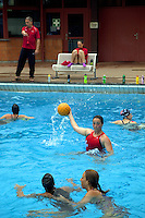 Switzerland. Canton Ticino. Tenero. Centro Sportivo Nazionale della Gioventù - Tenero (CST). Nationales Jugendsportzentrum Tenero. Vesselina Velikova is an athlete from the swiss water polo team. Water polo player throwing ball while training with her team in the swimming pool. Water polo is a team water sport. The playing team consists of six field players and one goalkeeper. Gameplay involves swimming, treading water, players passing the ball while being defended by opponents, and scoring by throwing into a net defended by a goalie. 31.05.11 © 2011 Didier Ruef