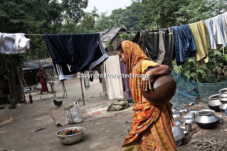 Jamsed Gazi's second wife and Siraj's step-mother, Murjina Bibi seen carrying on with her household chores in her house in Chaymalpur village of North 24 Parganas in West Bengal, India. Photo: Sanjit Das/Panos for The Wall Street Journal. Slug: ICASTE