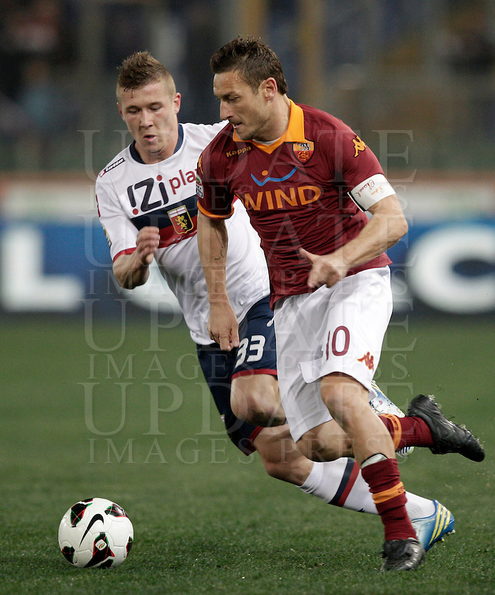 Calcio, Serie A: Roma vs Genoa. Roma, stadio Olimpico, 3 marzo 2013..AS Roma forward Francesco Totti, right, is challenged by Genoa midfielder Jurai Kucka, of Slovakia, during the Italian Serie A football match between AS Roma and Genoa at Rome's Olympic stadium, 3 March 2013..UPDATE IMAGES PRESS/Riccardo De Luca