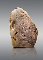 """Prehistoric  petroglyphs, rock carvings, carved by the the prehistoric Camuni people in the Copper Age around the 3rd milleneum BC, Stele """"Bagnolo 2"""" found in 1972 from Malegno near Bangnolo Ceresolo. Museo Nazionale della Preistoria della Valle Camonica ( National Museum of Prehistory in Valle Cominca ), Lombardy, Italy. Grey Background"""