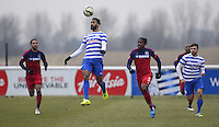 Armand Traore of QPR wins a header from Lovel Palmer of Chicago Fire
