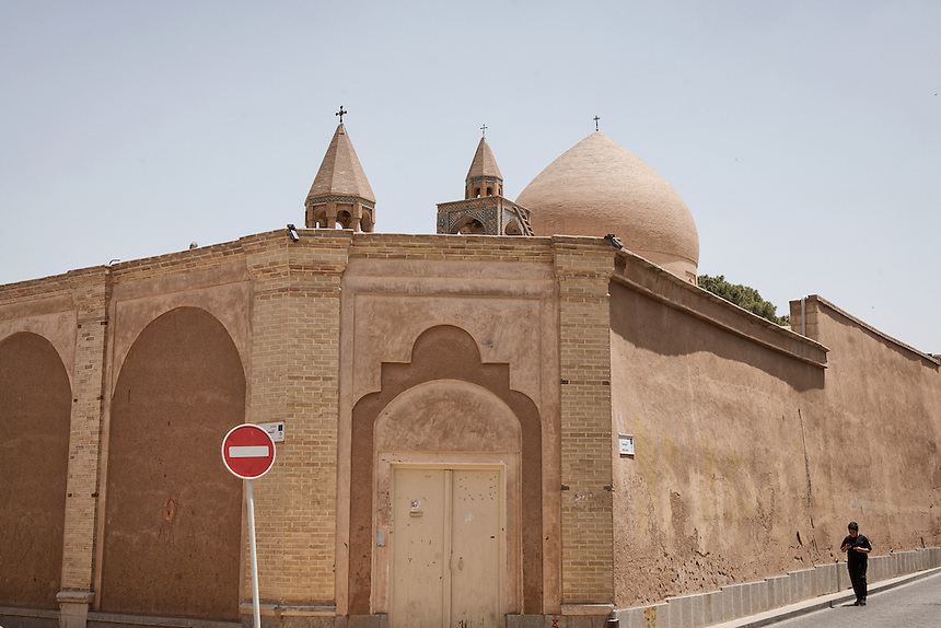 A man walks beside the wall of Vank Cathedral of Isfahan. This cathedral is one the fine example of Armenian church in Iran. It was built between 1606 to 1655 with the encouragement and approval of the Safavid rulers at taht time.
