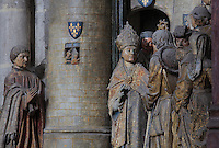 The donor Adrien de Henencourt kneeling on the left, and the arrival of St Firmin in Amiens, welcomed by senator Faustinien, Gothic style polychrome high-relief sculpture from the South side of the choir screen, 1490-1530, commissioned by canon Adrien de Henencourt, depicting the life of St Firmin, at the Basilique Cathedrale Notre-Dame d'Amiens or Cathedral Basilica of Our Lady of Amiens, built 1220-70 in Gothic style, Amiens, Picardy, France. St Firmin, 272-303 AD, was the first bishop of Amiens. Amiens Cathedral was listed as a UNESCO World Heritage Site in 1981. Picture by Manuel Cohen