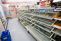 Mar. 12, 2011 - Tokyo, Japan - Convenient store shelves are swept clean of any food available for purchase after the powerful 8.9-magnitude quake hit north-eastern Japan followed by a devastating tsunami, killing over 1,000 people, according to government reports..