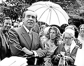 Washington, DC - June 12, 1971 -- United States President Richard M. Nixon looks up at the sky and rain as he speaks to reporters prior to the wedding of his daughter, Tricia Nixon, to Edward Cox at the White House in Washington, D.C. on Saturday, June 12, 1971.  The rain held off and the wedding proceeded as planned in the Rose Garden..Credit: Bill Allen / CNP