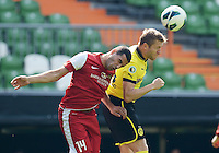 FUSSBALL   DFB POKAL   SAISON 2012/2013   1. Hauptrunde FC Oberneuland - Borussia Dortmund            18.08.2012 Sedat Yuecel (li, FCO) gegen Jakub  KUBA Blaszczykowski (re, Borussia Dortmund)