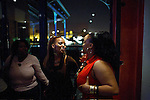 SOWETO, SOUTH AFRICA SEPTEMBER 2: Up-market black women dance on September 2, 2006 in the Backroom, a trendy club in Soweto, Johannesburg, South Africa. As more residents have a disposable income, trendy clubs and restaurants open. Soweto is South Africa?s largest township and it was founded about one hundred years to make housing available for black people south west of downtown Johannesburg. The estimated population is between 2-3 million. Many key events during the Apartheid struggle unfolded here, and the most known is the student uprisings in June 1976, where thousands of students took to the streets to protest after being forced to study the Afrikaans language at school. Soweto today is a mix of old housing and newly constructed townhouses. A new hungry black middle-class is growing steadily. Many residents work in Johannesburg but the last years many shopping malls have been built, and people are starting to spend their money in Soweto.  .(Photo by Per-Anders Pettersson/Getty Images).