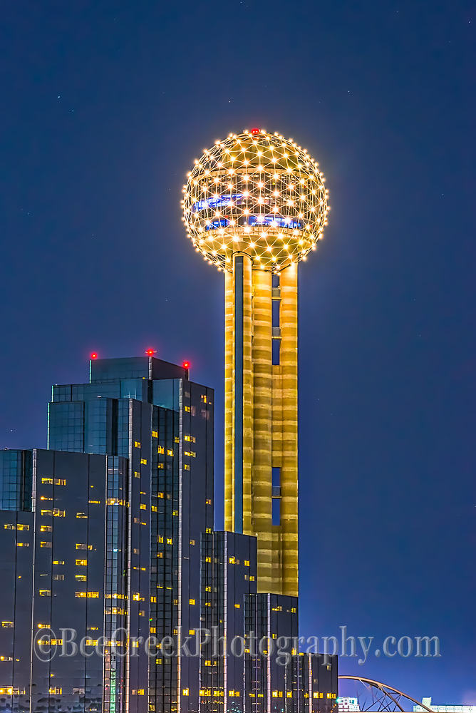 Reuion Tower in downtown Dallas after dark with only the light from the tower and the Hyatt Regency in view.
