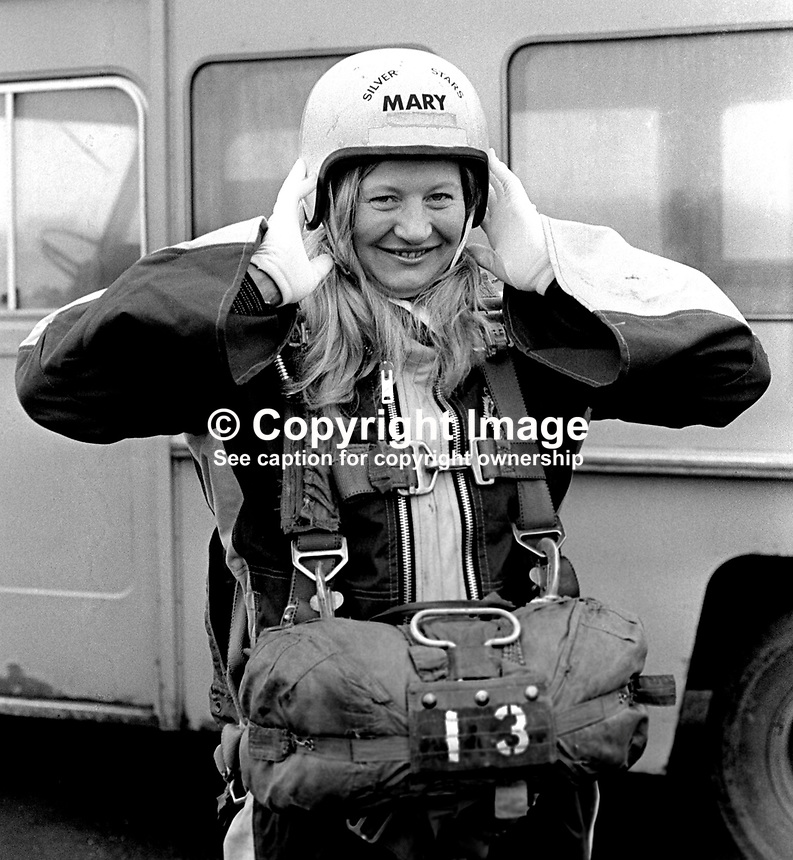 Mary Peters, N Ireland, Gold Medallist, 1972 Munich Olympics women's pentathlon, ready for her first ever parachute jump over Newtownards Airport, Co Down, N Ireland. Obviously not superstitious using parachute number 13. 26th November 1974. 197411260667a..Copyright Image from Victor Patterson, 54 Dorchester Park, Belfast, United Kingdom, UK...For my Terms and Conditions of Use go to http://www.victorpatterson.com/Victor_Patterson/Terms_%26_Conditions.html