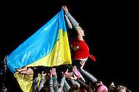 "Deriugina School gymnasts of Ukraine perform gala exhibition before 2007 World Cup Kiev, ""Deriugina Cup"" in Kiev, Ukraine on March 16, 2007. With Ukrainian flag is Daria Kushnerova."