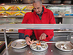 Man preparing fresh seafood, Paris, France