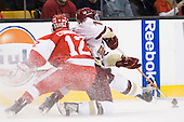 Chris Connolly (BU - 12), Brian Gibbons (BC - 17) - The Boston College Eagles defeated the Boston University Terriers 3-2 (OT) in their Beanpot opener on Monday, February 7, 2011, at TD Garden in Boston, Massachusetts.