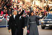 United States President Barack Obama and First lady Michelle Obama walk the route as the presidential inaugural parade winds through the nation's capital January 21, 2013 in Washington, DC. Barack Obama was re-elected for a second term as President of the United States.  .Credit: Chip Somodevilla / Pool via CNP