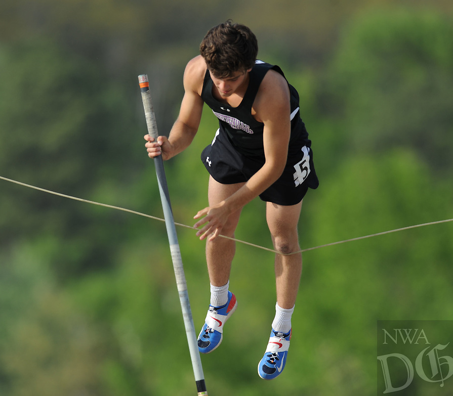 NWA Democrat-Gazette/ANDY SHUPE<br /> Fayetteville senior Hootie Hurley warms up Friday, April 14, 2017, for the pole vault during the Bulldog Relays at the Fayetteville High School outdoor track. Hurley signed a letter of intent to compete for Oklahoma State.