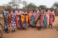 Group of indigenous Masai women singing and smiling as they welcome guests in Kenya, Africa (photo by Travel Photographer Matt Considine)