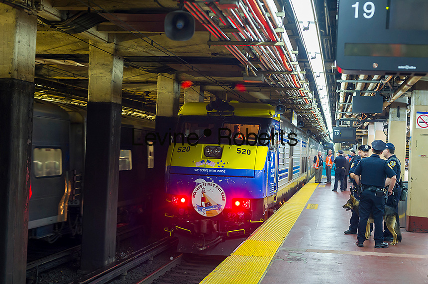 The Cannonball departs Penn Station in New York on the Memorial Day weekend on Friday, May 27, 2016. Every Friday during the summer the train, consisting of double-decker cars pulled by a powerful dual-mode locomotive, will run express to Westhampton on Long Island making the 76 mile trip in 94 minutes. From Westhampton it will continue to points east arriving at the tip of the island, Montauk. On Sundays the train will reverse and return to Penn Station. The train is the only named run on the railroad. The trip from Penn Station to the Montauk terminal is 117 miles making the train the longest run on the railroad. (© Richard B. Levine)