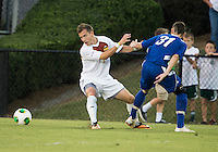Winthrop University Eagles vs the Brevard College Tornados at Eagle's Field in Rock Hill, SC.  The Eagles beat the Tornados 6-0.  Patrick Barnes (11) moves to the ball evading a challenge from Rhem Stubbs (31).