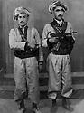 Iraq 1970? .Peshmergas of Herki tribe posing in a studio .Irak 1970? .Peshmergas de la tribu Herki posant dans un studio