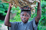 "A woman carries a load of firewood on her head in Chidyamanga, a village in southern Malawi that has been hard hit by drought in recent years, leading to chronic food insecurity, especially during the ""hunger season,"" when farmers are waiting for the harvest."