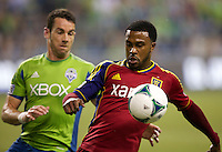 Robbie Findley, right, of Real Salt Lake battles Zach Scott of the Seattle Sounders FC during play at CenturyLink Field in Seattle Friday September 13, 2013. The Sounders won the match 2-0.
