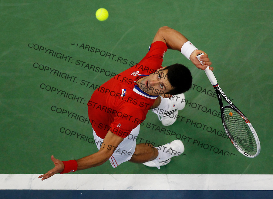 BELGRADE, SERBIA - NOVEMBER 15: Novak Djokovic of Serbia serves the ball to Radek Stepanek of Czech Republic during the day one of the final Davis Cup match between Serbia and Czech Republic on November 15, 2013 in Belgrade, Serbia. (Photo by Srdjan Stevanovic/Getty Images)
