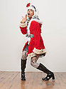 Man in drag, wearing dress, go go boots, white wig and red santa claus jacket, dancing on white background
