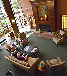 Interior photo of people relaxing in main living room of senior apartments.