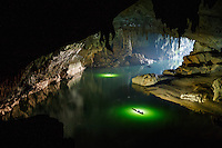 Cavers paddle out of the downstream entrance of the Xe Bang Fai River Cave (Tham Khuon Xe) in Hin Nam No National Park in Laos. Tham Khuon Xe is one of the largest river caves, any cave that has an active water source flowing through it, in the world.