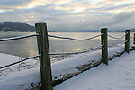 A snow covered cable fence at the North Idaho College Beach on the North Shore of Lake Coeur d' Alene, Idaho on a winter day